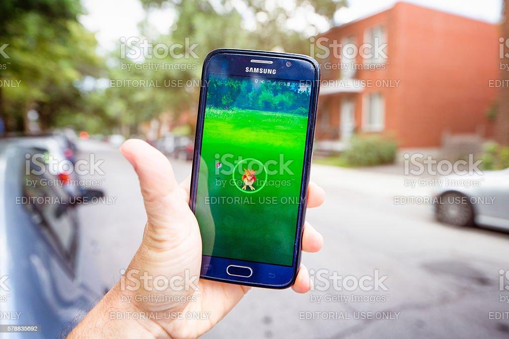 Pokemon go on Samsung phone lifestyle image urban setting stock photo