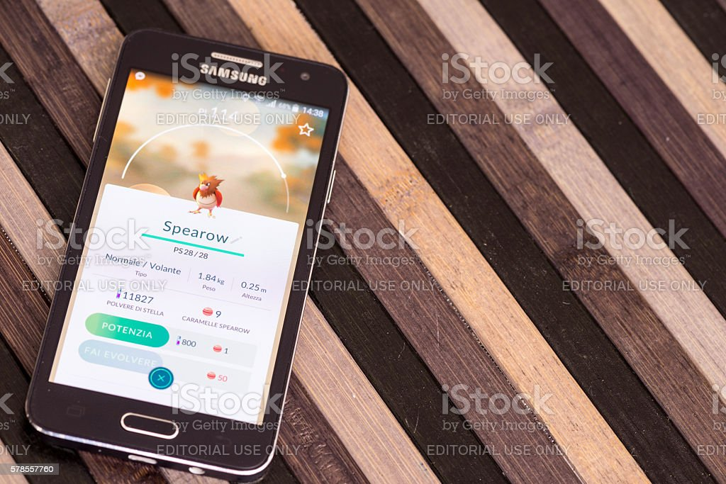 Pokemon go on Samsung smartphone on striped wood table stock photo