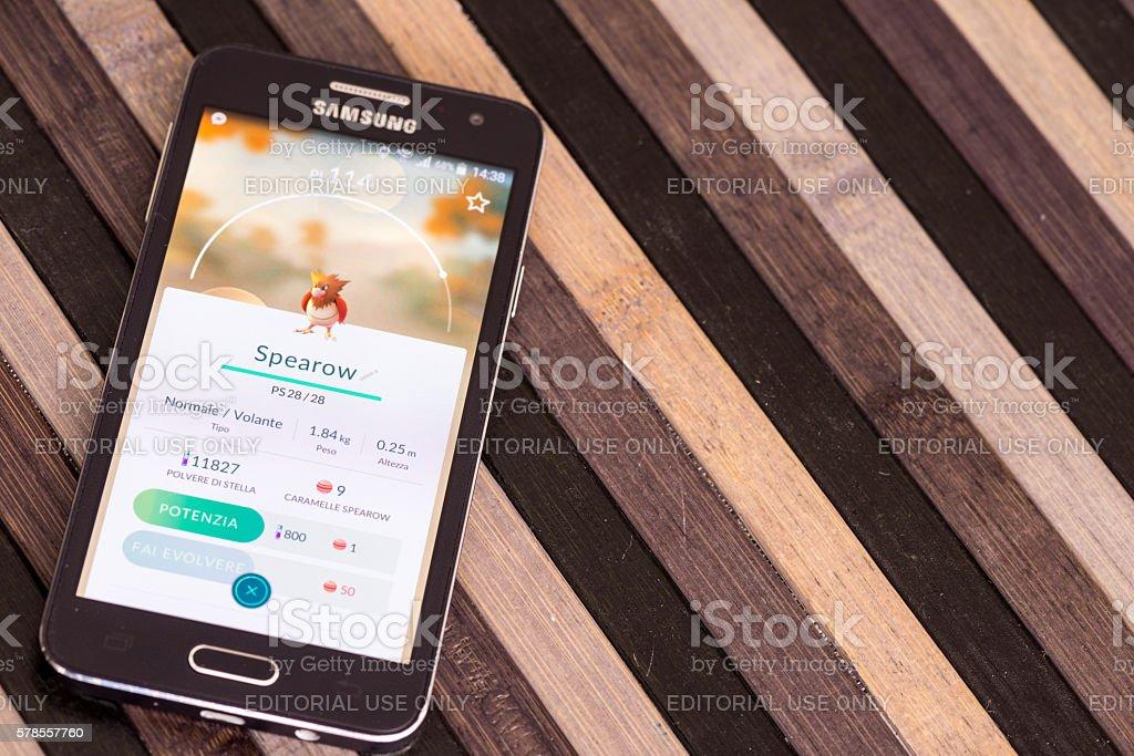 Pokemon go on Samsung smartphone on striped wood table stock photo