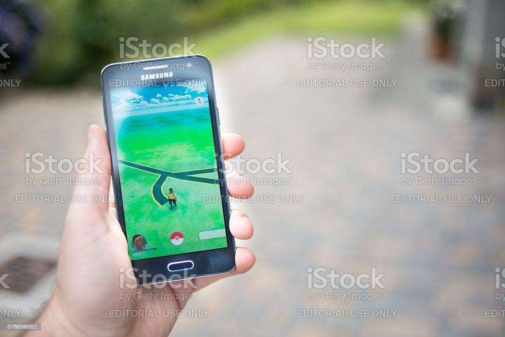 Pokemon go on Samsung smartphone outdoor stock photo