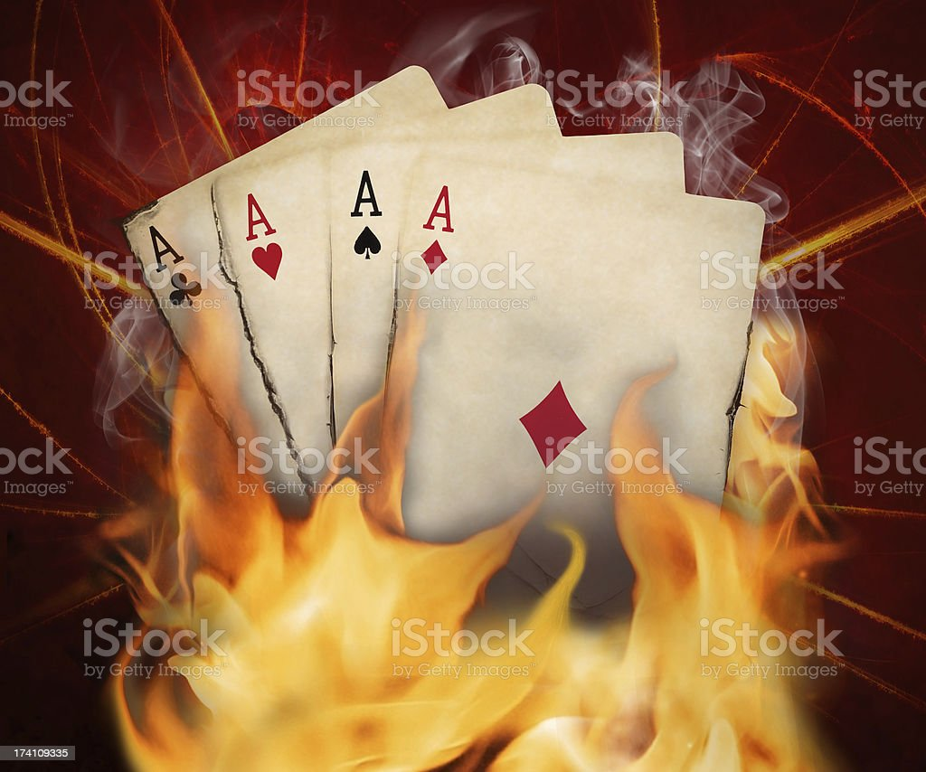 Poker cards burn in the fire royalty-free stock photo