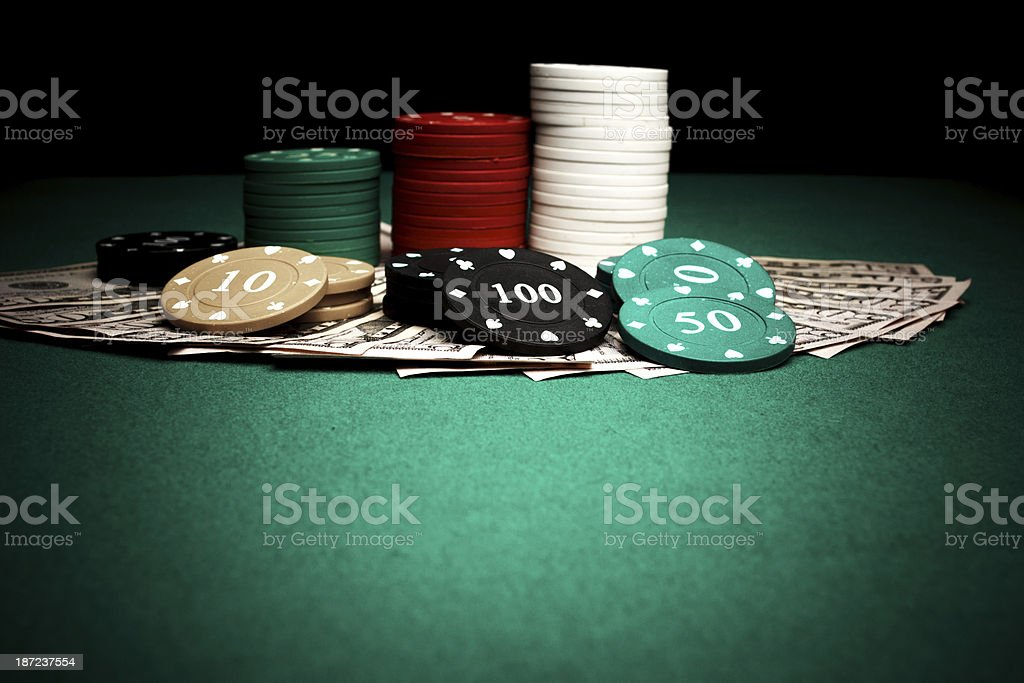 Poker chips and dollars royalty-free stock photo