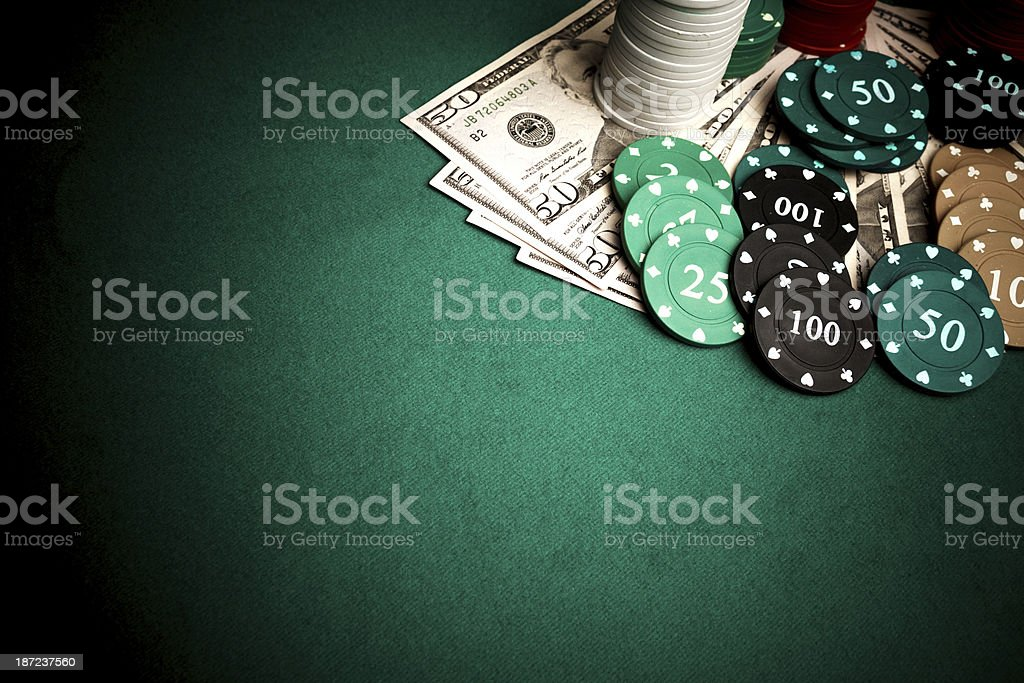 Poker chips and dollars stock photo