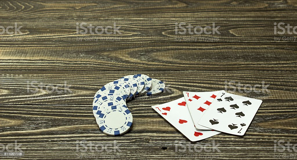 Poker chips and playing cards on the table stock photo