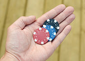 Poker Chips in Hand
