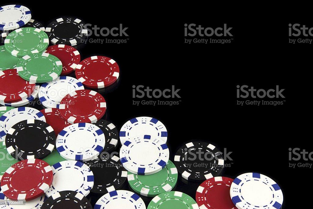 Poker chips on black background royalty-free stock photo