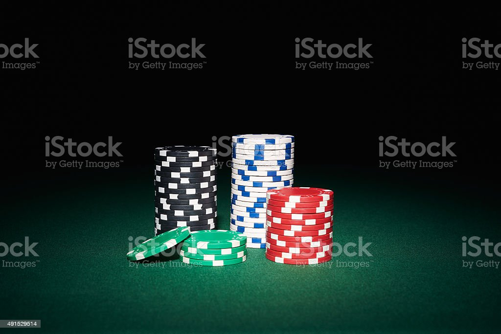 Poker chips on table stock photo
