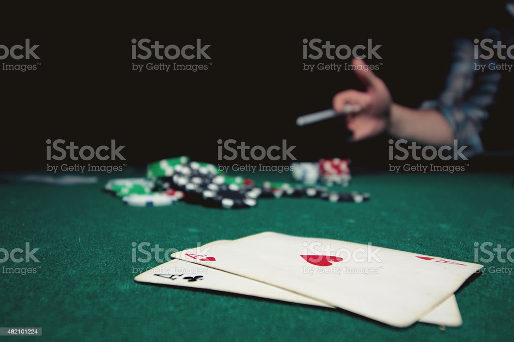 poker chips on the cloth combination of cards stock photo