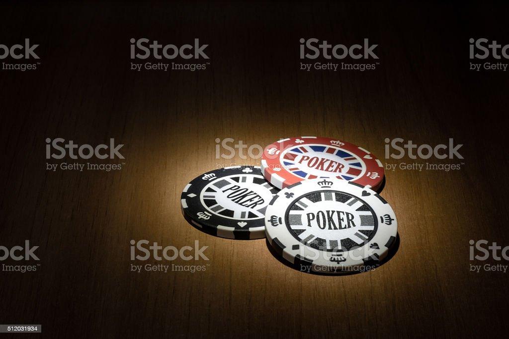 Poker chips on the spotlight stock photo