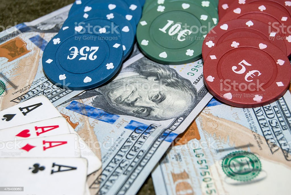 Poker chips, playing card and dollar bills background stock photo
