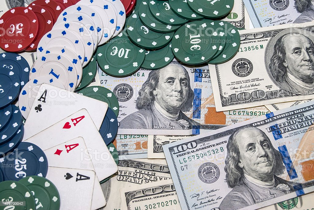 Poker chips, playing cards and usa dollars bills in casino stock photo