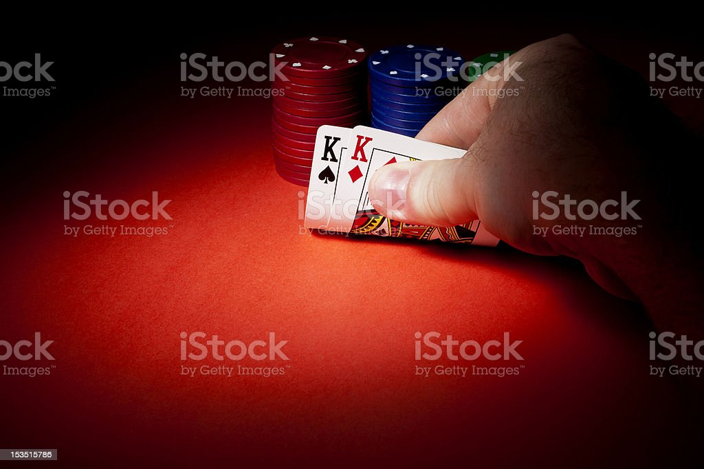Poker Chips, Pocket Kings, and Copyspace stock photo