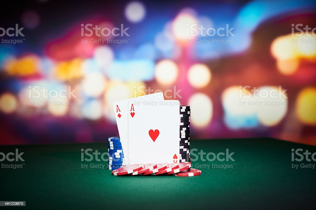 Poker chips with aces cards stock photo