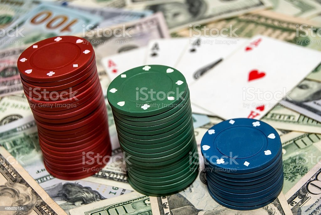Poker chips with cards on the dollars background stock photo