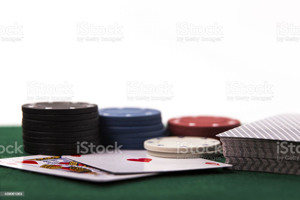 Poker Chips with Cards on White Background stock photo