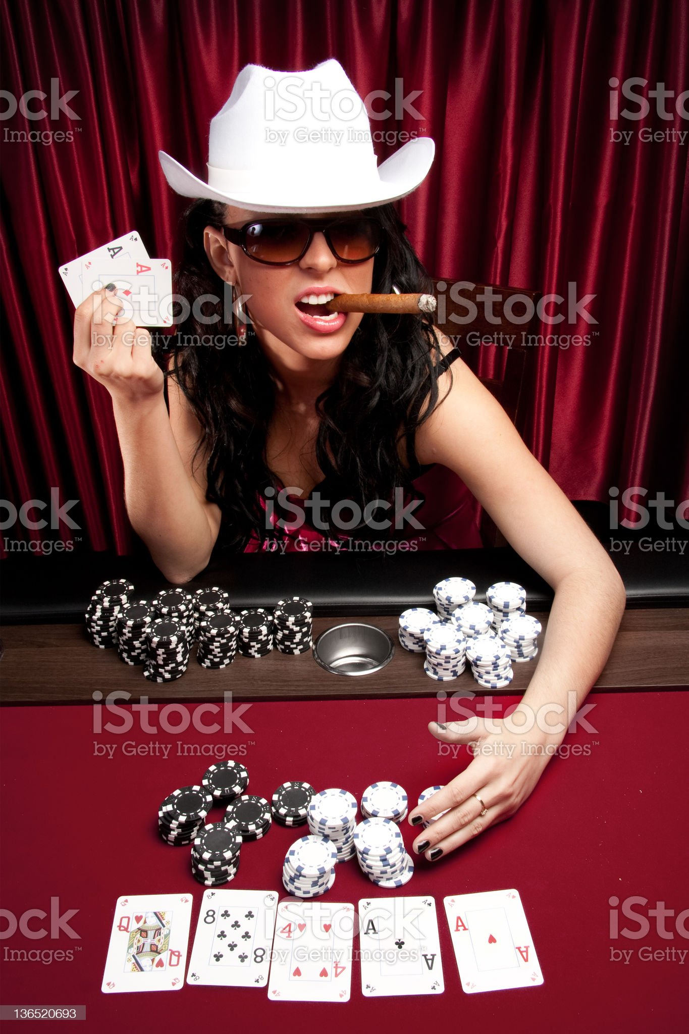 Poker diva hauling the chips royalty-free stock photo