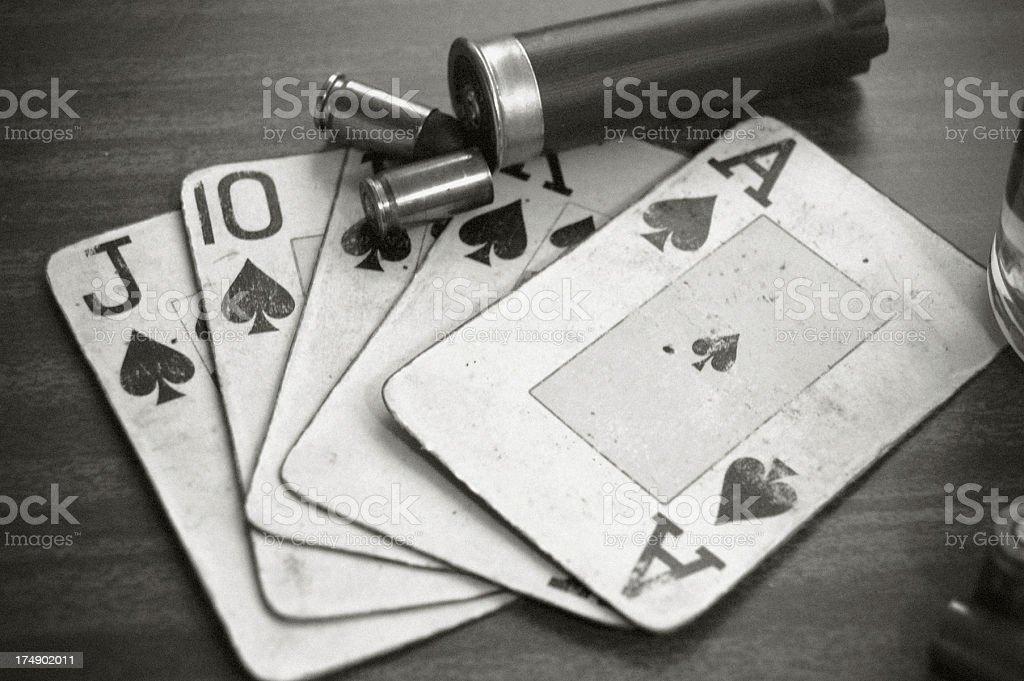 Poker Hand & Bullets royalty-free stock photo