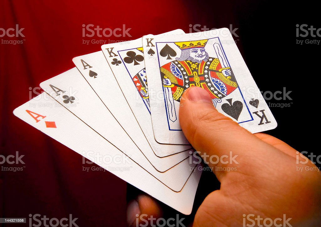 Poker Hands holding a Full House stock photo