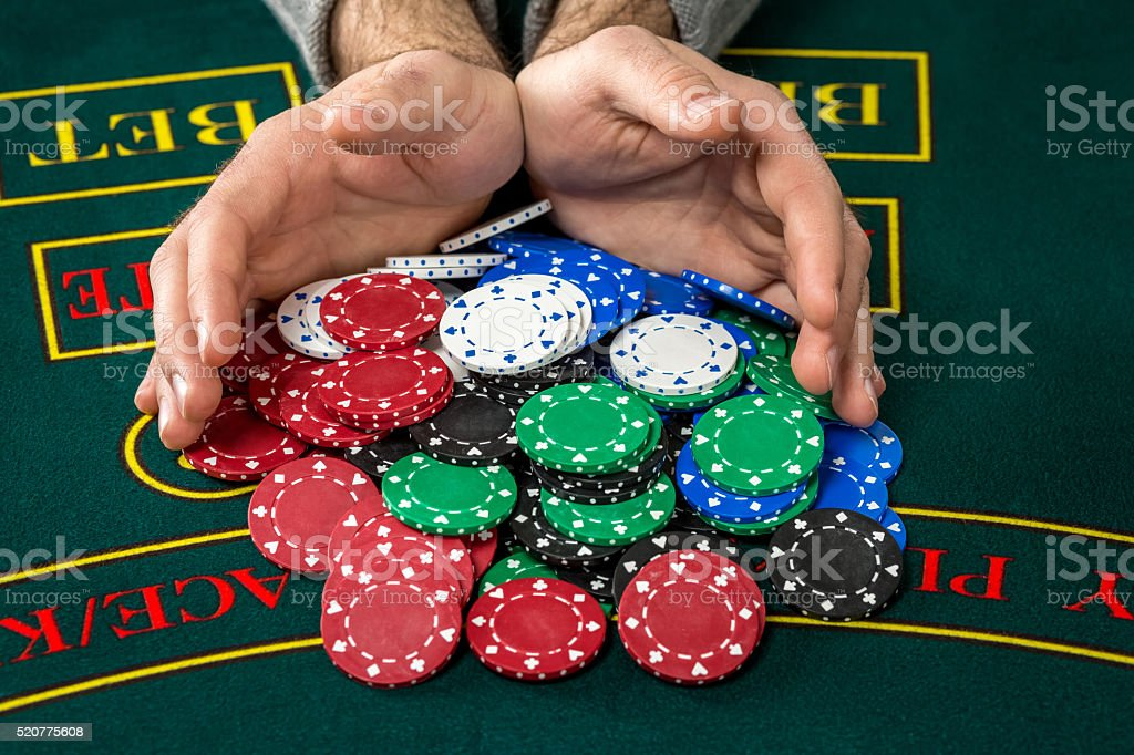 Poker play. Chips and cards stock photo