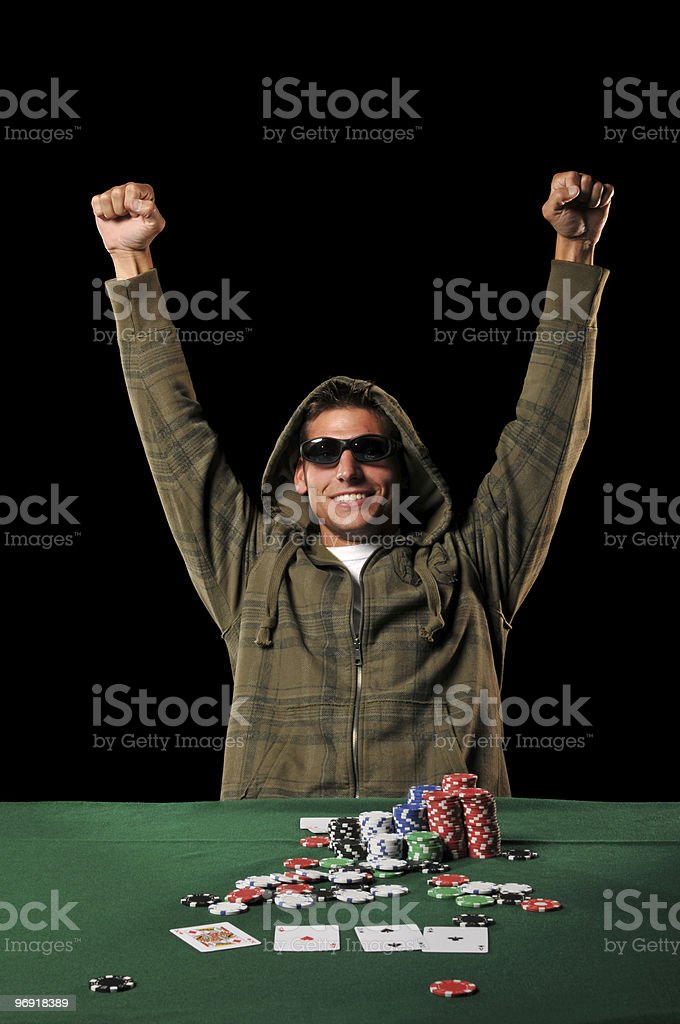 Poker player celebrating with extended arms stock photo