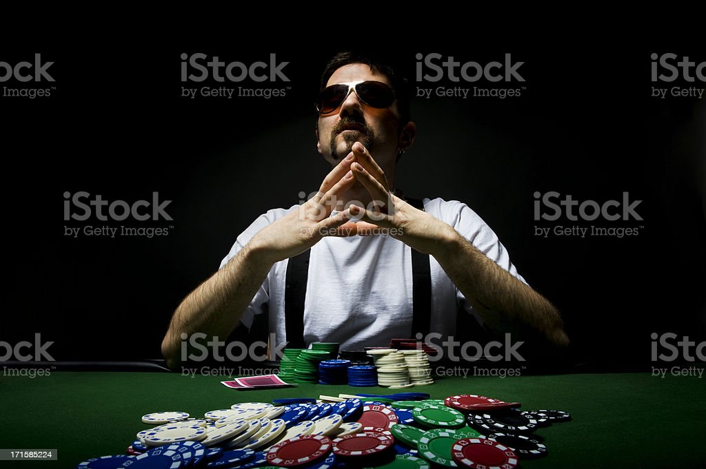 Poker Player contemplating stock photo