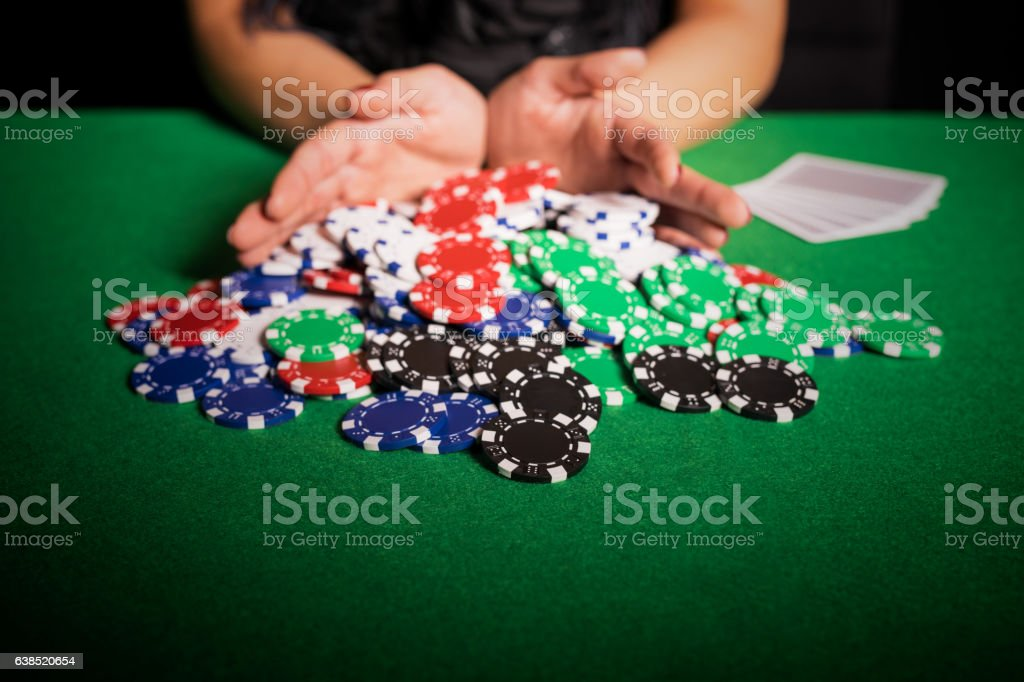 Poker player going all in stock photo