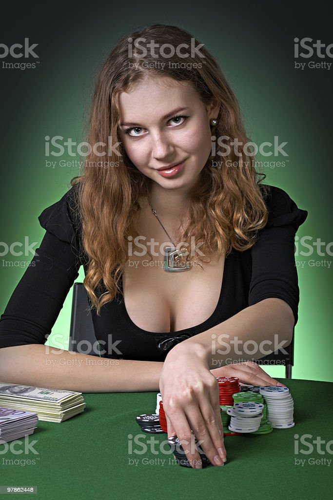 Poker player in casino with cards and chipsv royalty-free stock photo