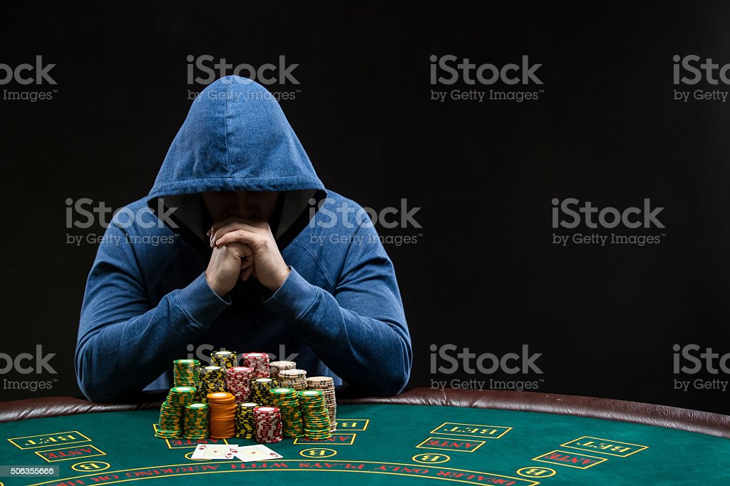 Poker player looking at combination of two aces. Closeup stock photo