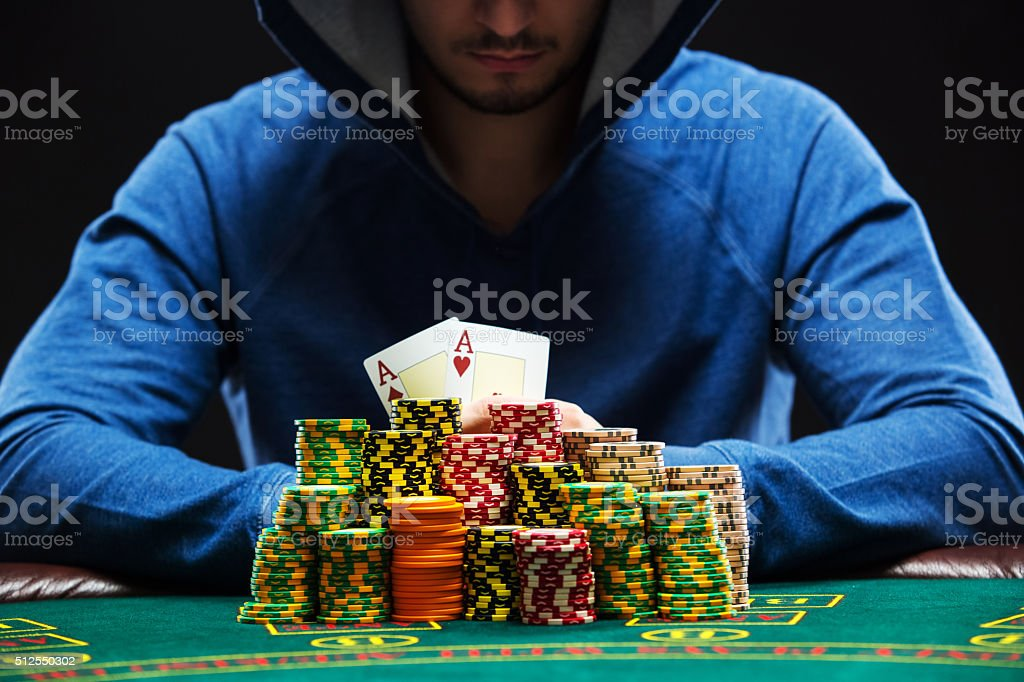 Poker player showing a pair of aces stock photo