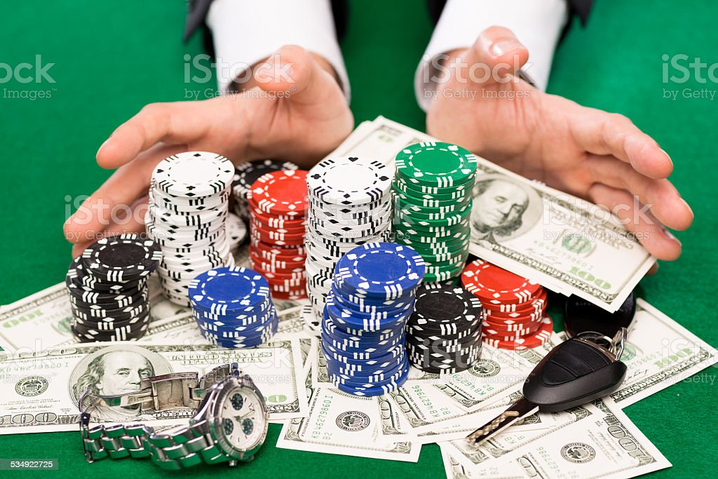 poker player with chips and money at casino table stock photo