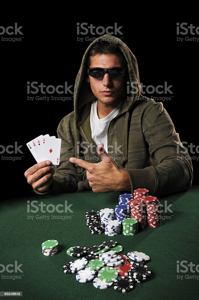 Poker PLayer With Four Aces stock photo