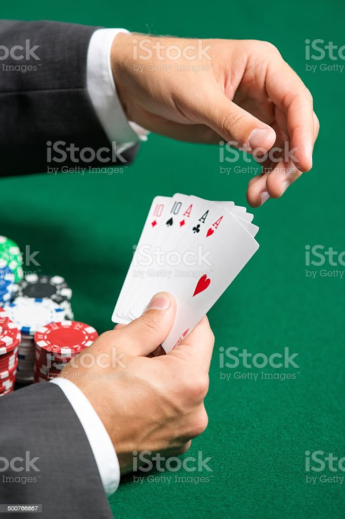 Poker player with full house on hands stock photo