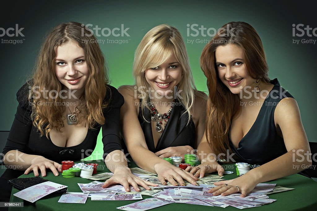 Poker players in casino with cards and chipsv stock photo