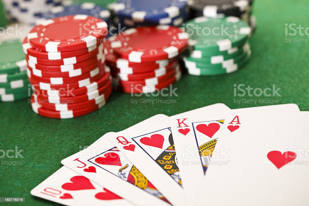 Poker, royal flush and gambling chips. stock photo