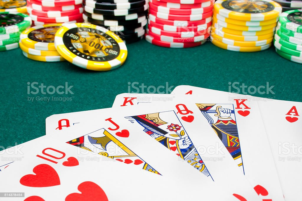 poker, royal flush and unfocused gambling chips stock photo