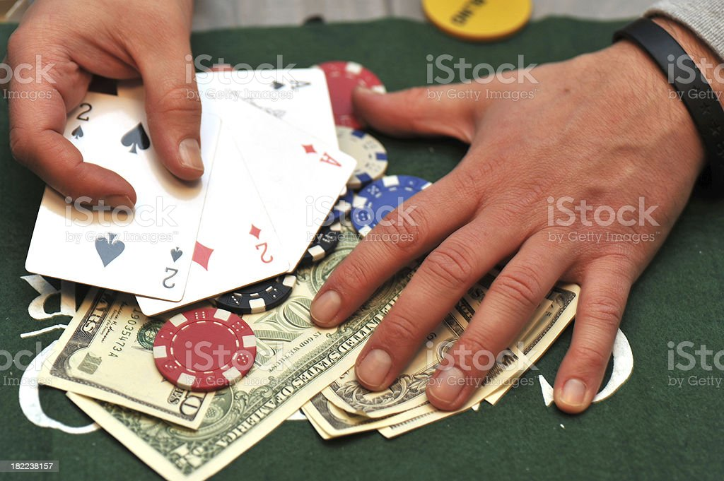 poker success hand with dollars and playing cards stock photo