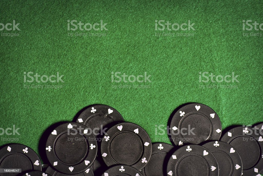 Poker table with black gambling chips stock photo