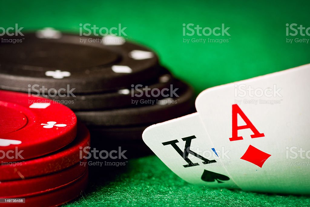 Poker table with poker chips and an ace and a king cards stock photo