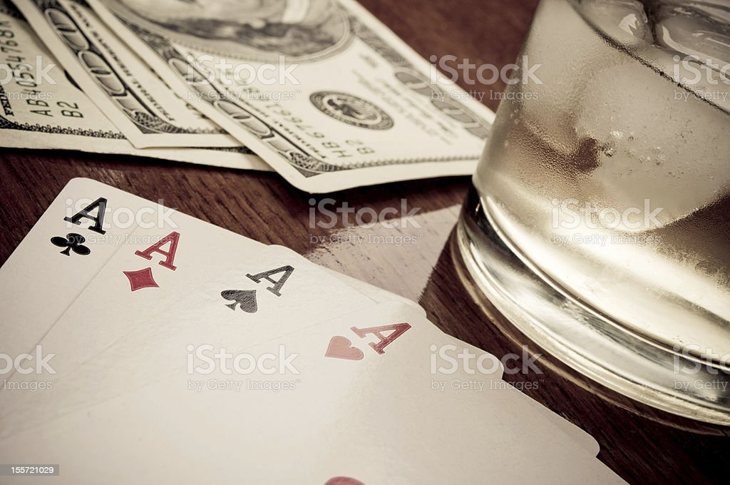 Poker, whiskey and Dollars royalty-free stock photo