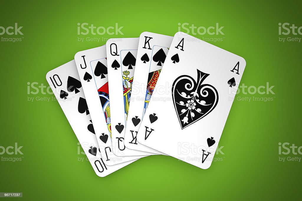 Poker winning hand over a vivid green background. stock photo