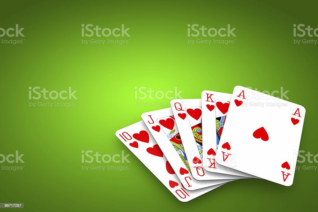Poker winning hand over a vivid green background. royalty-free stock photo