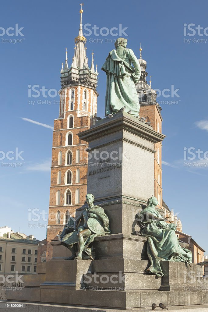 Poland, Krakow, Mickiewicz Monument, st Mary Curch Towers, Midday stock photo