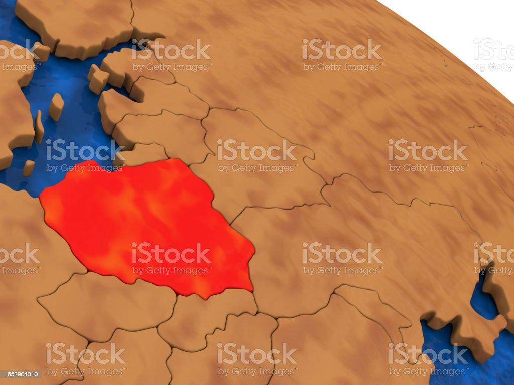 Poland on wooden globe stock photo