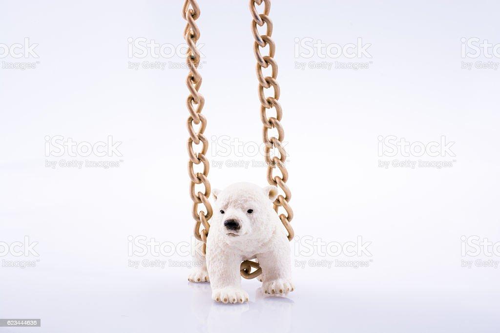 Polar bear cub and chain stock photo