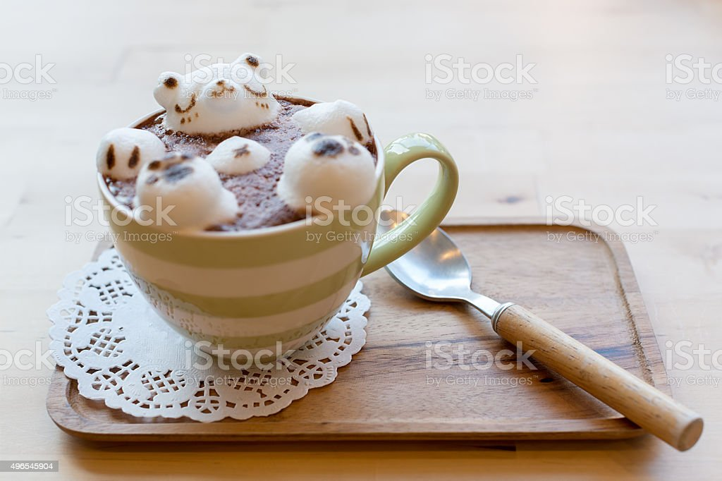 Polar bear floating in hot cappuccino stock photo