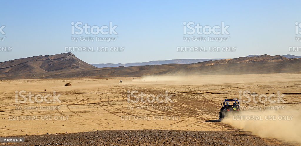Polaris RZR 800 with it's pilot in Morocco desert stock photo