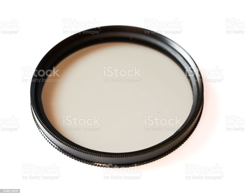 Polarizing and fluorescence lens filter isolated on white background, photo abstract stock photo