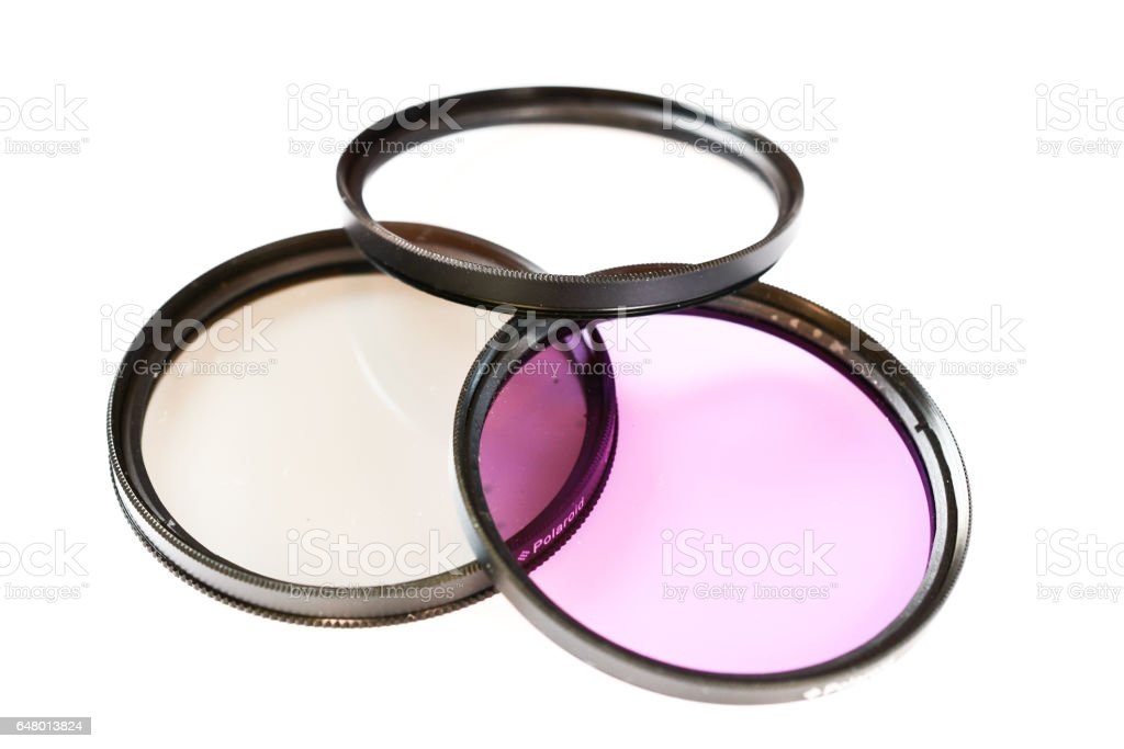 Polarizing, protect and fluorescence lens filter isolated on white background, photo abstract stock photo