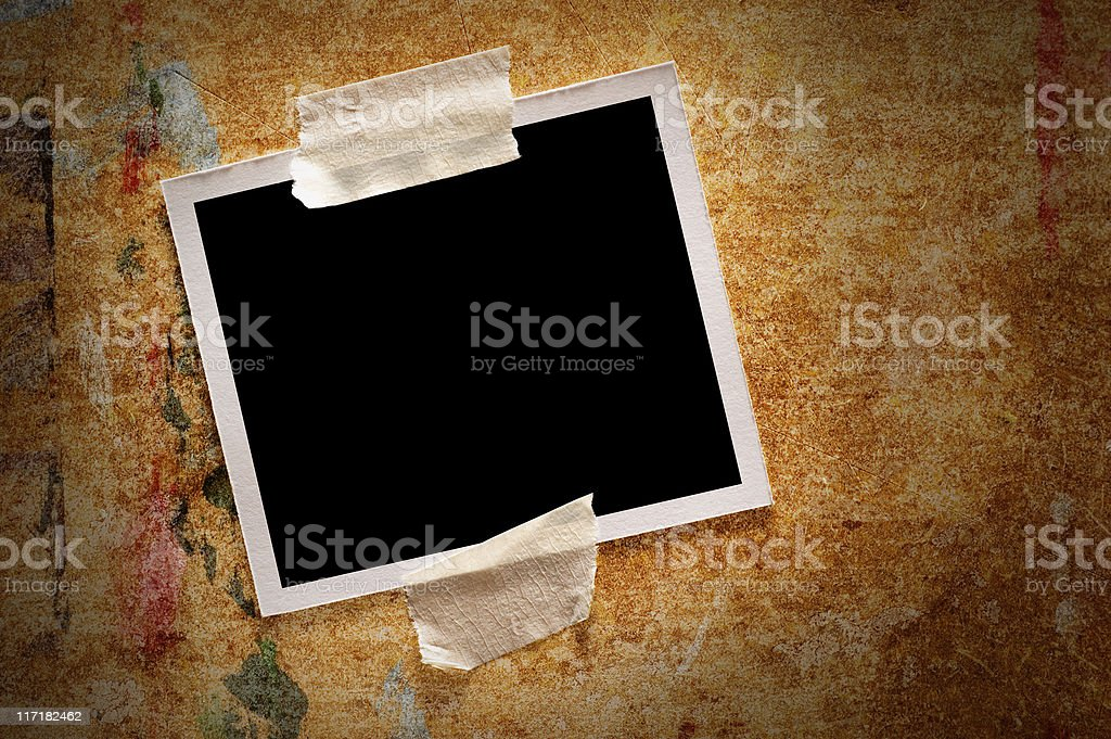 Polaroid frame on a rusty wood background royalty-free stock photo