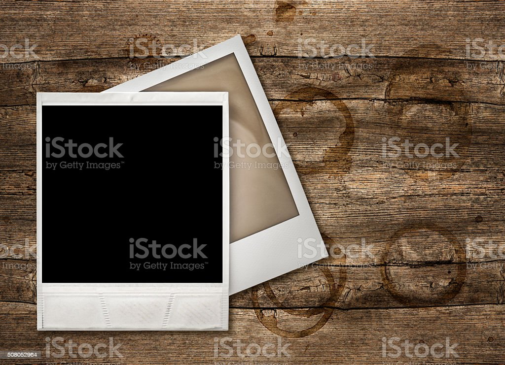 Polaroid Photo Frames over wooden background stock photo